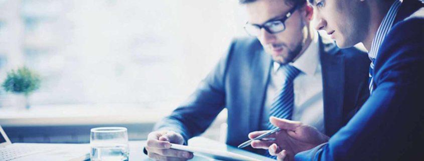 2 businessmen looking at data